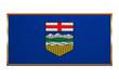 Flag of Alberta, golden frame, fabric texture