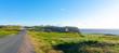 Road to Cape Bona Vista lighthouse station, Newfoundland,  Panoramic vista, bright blue late summer morning over Atlantic Canada.