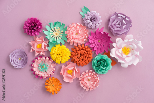 Colourful handmade paper flowers on pink background Poster