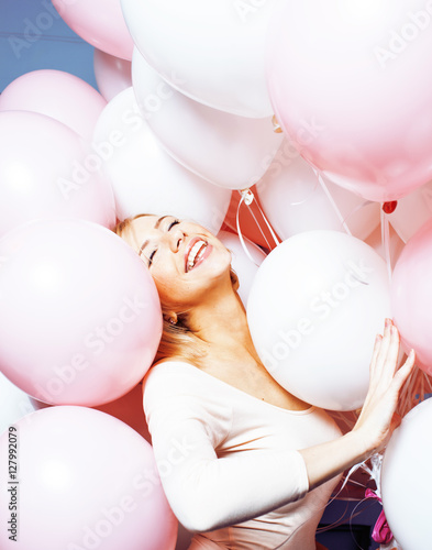 Poster young happy blonde real woman with baloons smiling close up, lifestyle people co