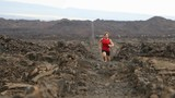 Man running outdoor sprinting for success. Male fitness runner on lava trail. Sport athlete in sprint at great speed in beautiful landscape in nature. 59.94 FPS SLOW MOTION.