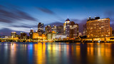 Pittsburgh downtown skyline at dawn viewed from North Shore Riverfront Park across Allegheny River.