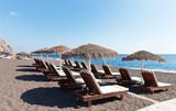 Greece. South-east coast of Santorini. The beaches of black volcanic sand of Perissa - 128005636