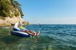 Senior man floating in sea
