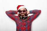 Hipster man with christmas beard and santa hat