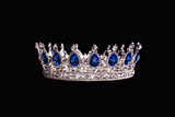 Royal crown with sapphire on black background - 128037438