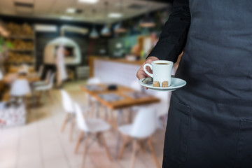 waitress serving cup of coffee