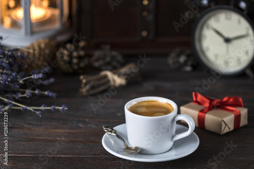Poster cup of aroma black espresso on wooden table with little present, lavender and de
