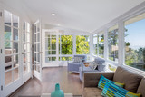 Bright solarium-style sunroom off the master suite.
