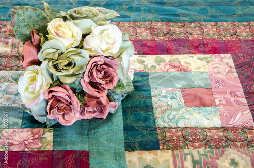 Poster Silk flowers on a vintage home made quilt in trendy BOHO style