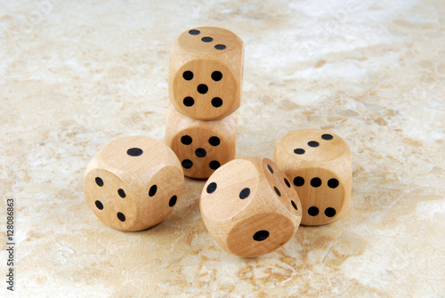 closeup of the dices on marble stone table плакат
