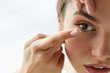 Vision Contact Lenses. Closeup With Beautiful Woman Face