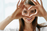 Beautiful Happy Woman Showing Love Sign Near Eyes. - 128089406