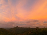 Pastel Purple and Orange Color of the Sunset Sky over Mountain Range in Thailand