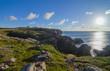 Cape Bona Vista coastline in Newfoundland, Canada.  Lighthouse station atop the end of the cape ahead on the horizon.