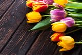 Colored fresh tulip on wood desk