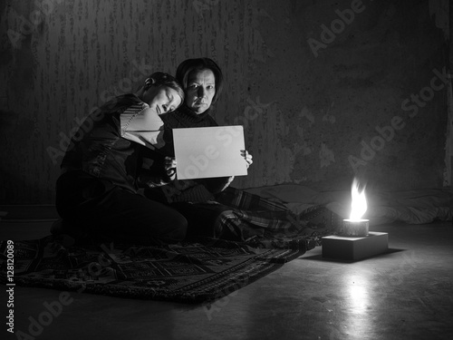 Poster Toned image Adult woman sitting on the floor and crying and the young boy put hi