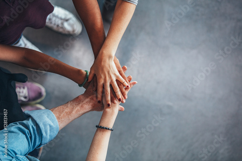 Group of young students showing unity