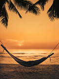 silhouette hammock on the beach - 128141879