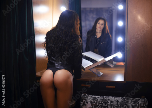 Beautiful woman in front of the mirror, sexy ass
