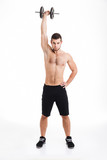 Athletic man with dumbbells