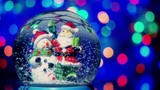 Christmas snow globe with Santa and snowman with new year tree lights twinkling.