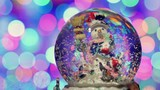 Christmas snow globe with snowman, with new year tree lights twinkling.