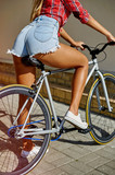 Beautiful sporty girl back on a sport fixed gear bike