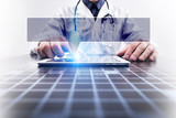 Medical doctor working with modern computer and pressing button with empty space for your text. Medical concept.