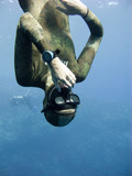 Freediver equalizing pressure while moving down