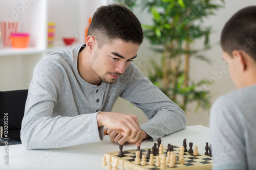 Poster two students playing chess