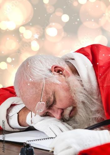 Poszter Tired santa claus sleeping at table