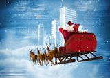 Santa clause riding reindeer sleigh against the city