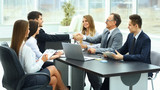 meeting business partners in a modern office - 128227085