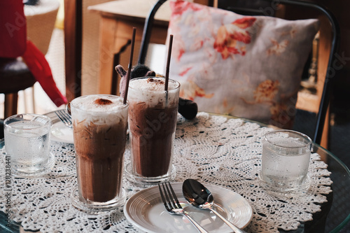 Poster Glass of Cold Iced Mocha Coffee in the Coffee shop, Vintage tone