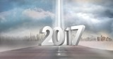 2017 against a composite image of road in sky