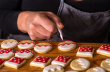 woman decorating gingerbread christmas cookies