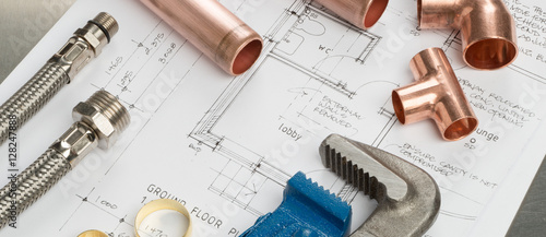 Foto Murales Plumbers Tools and Plumbing Materials Banner on House Plans