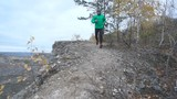 Sport Man jogging cross country running. . Fit male runner exercise training and jumping outdoors in mountain nature. Slow Motion.