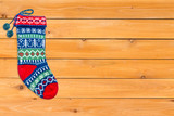 Single brightly colored woollen Christmas stocking