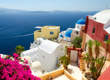 beautiful Oia village on Santorini island, Cyclades, Greece  - 128303639