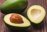 Fresh ripened avocado on a wooden background