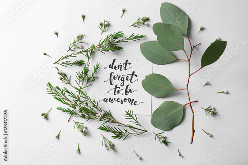 """Poster Quote """"Dont forget to be awesome"""" written on paper with leaves and flowers on white background"""