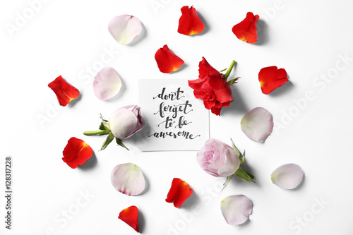 """Poster Quote """"Dont forget to be awesome"""" written on paper with petals and flowers"""