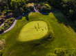 Aerial Photo of Men on a Golf Course Putting Green