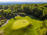 Aerial Photo of Men on a Golf Course Putting Green - 128317823