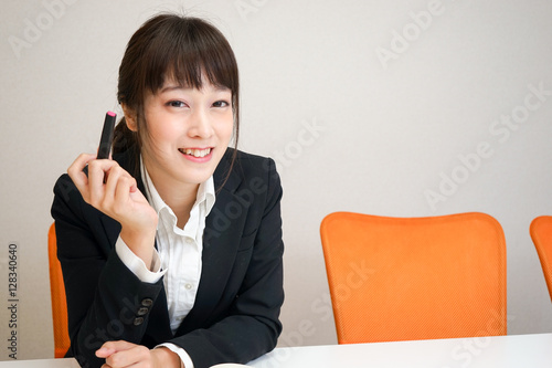 Poster Young woman thinking something at office