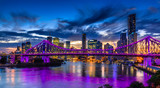 Vibrant night time panorama of Brisbane city with purple lights - 128353004
