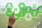 Internet of things(agriculture concept),smart farming,industrial agriculture.Farmer point hand to use augmented reality technology to control ,monitor and mangement in the field  - 128383234