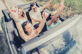 Group of young people dancing and having fun at car trip. - 128390663